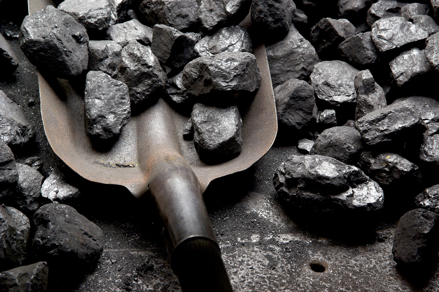 a shovel in a pile of coal